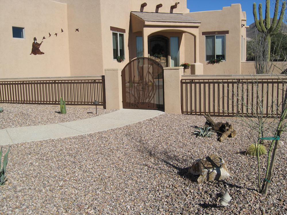 Decorative Arched Iron Gate with Ocotillo Motif and iron fence built in front of masonry wall - Installed in Tucson
