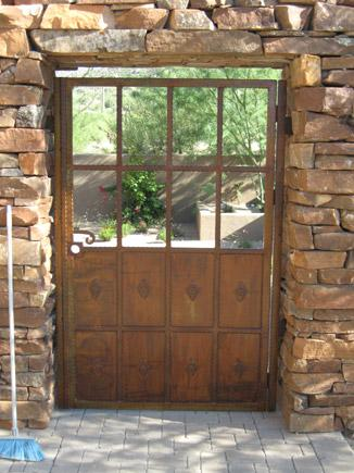 Hammered wrought iron gate solid steel kick plate in rush finish installed in Tucson IG100