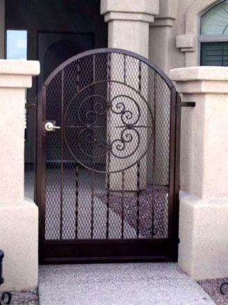 Ornamental Iron gate with arch, center scroll design and twisted pickets
