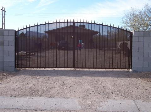 Large double wrought iron gate with spear points and perforated metal backing Tucson IG008