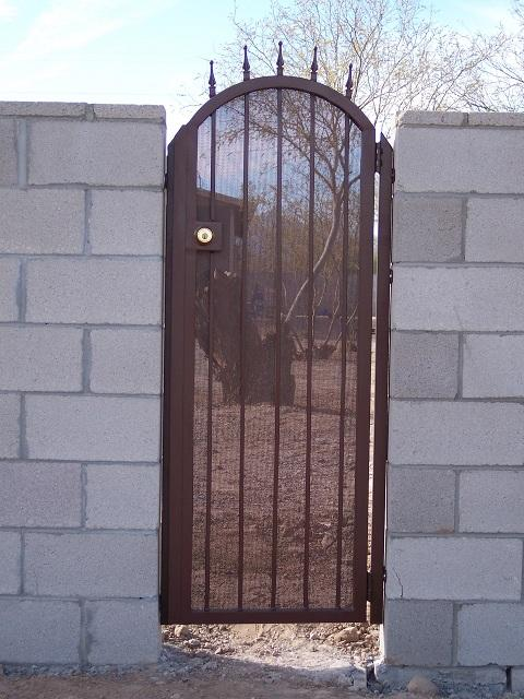 Narrow wrought iron gate with spear points and metal backing Tucson IG009