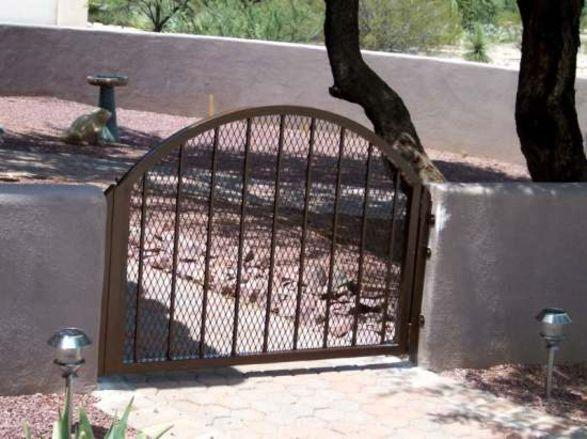 Small wrought iron garden gate with arched top and expanded steel backing IG079