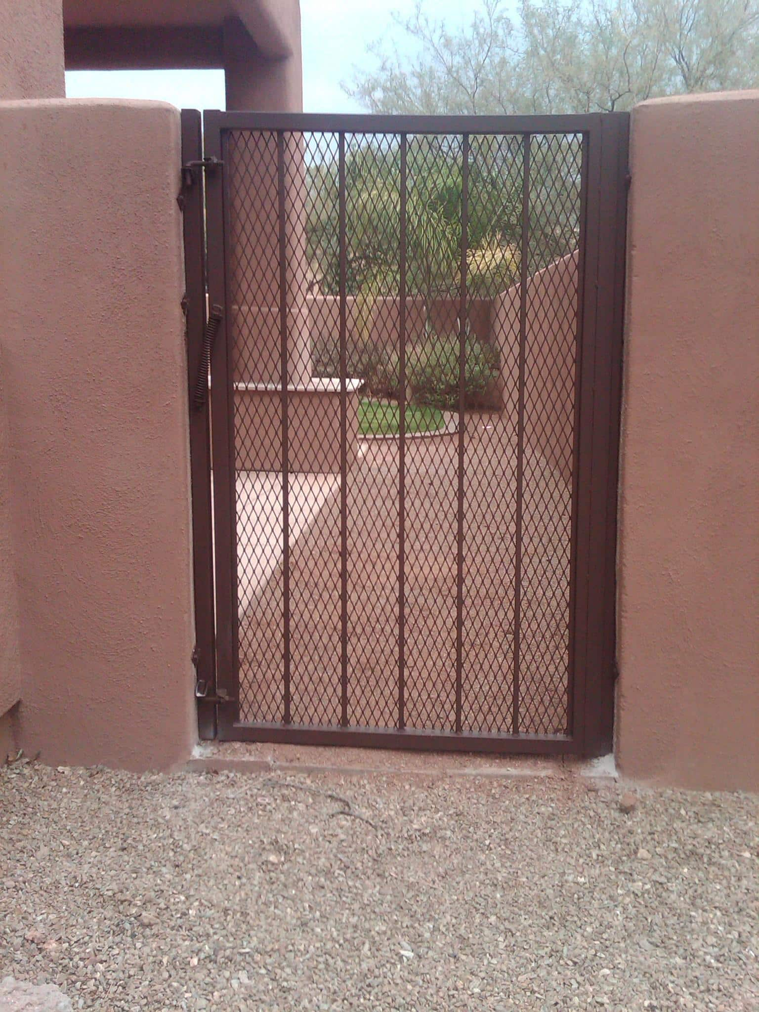wrought iron gate with expanded steel backing and spring-loaded closing mechanism tucson IG011
