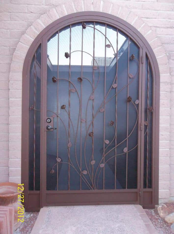 Arched porch enclosure with floral motif 6000 E - Made in Tucson