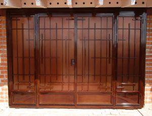 Double door porch security enclosure with geometric motifs 8000 E - Made in Tucson
