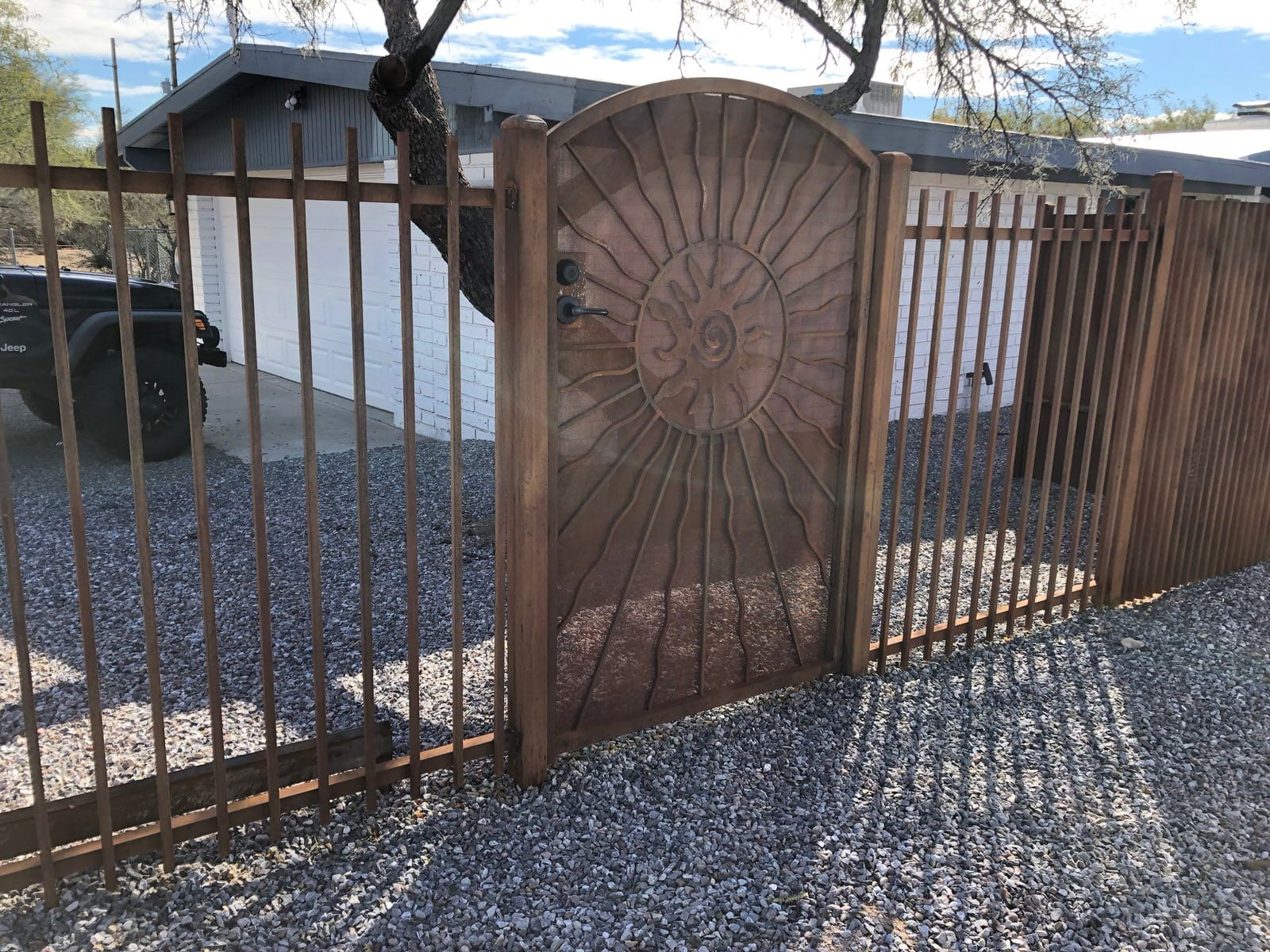 Iron fence and iron gate with rust patina and sun motif 1006