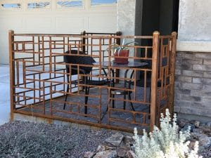 Iron fence with rust patina and a geometric motif creating a small enclosed patio 1696 - Installed in Tucson