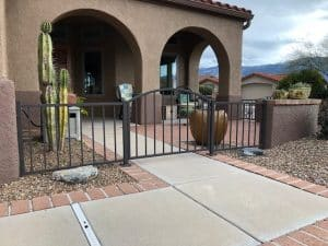 Low iron fence with arched iron gate 1119 - W Tucson