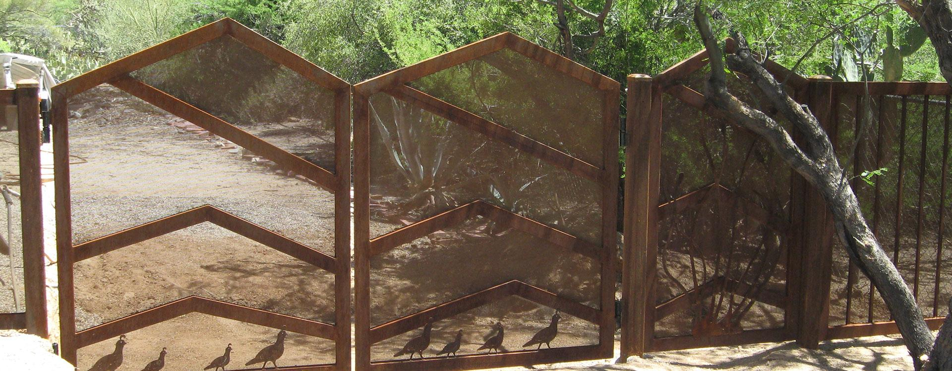 Modern style automatic driveway gates with mountain outline and quail cutouts