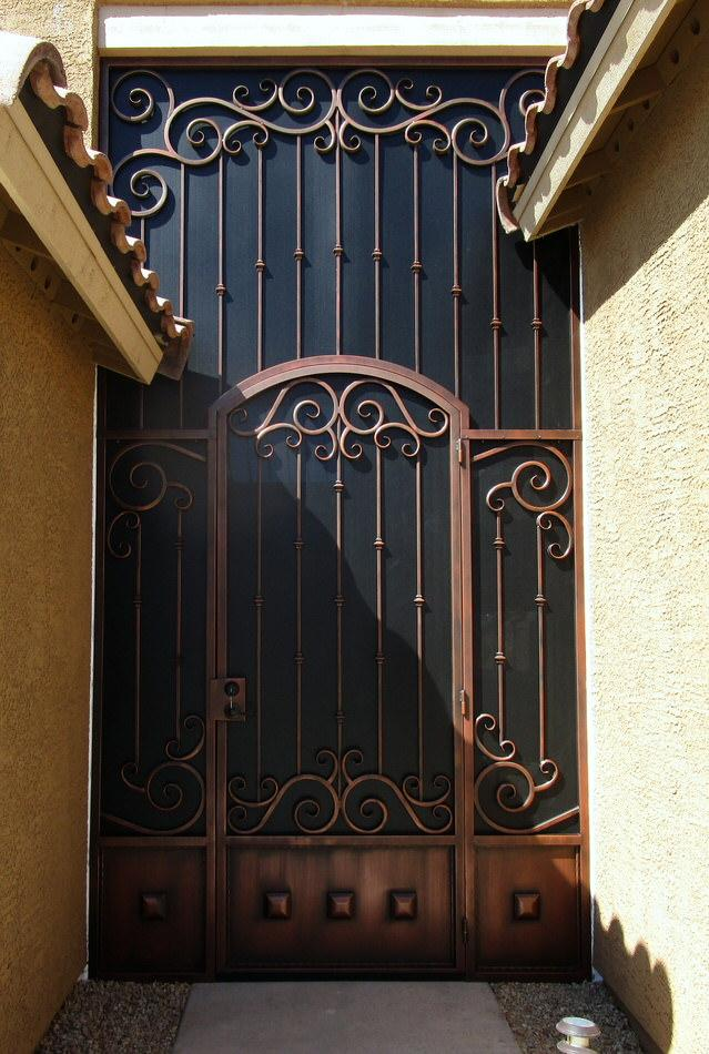 Ornamental wrought iron security door with swirls and knuckles and a high top panel 7019 E - Installed in Tucson