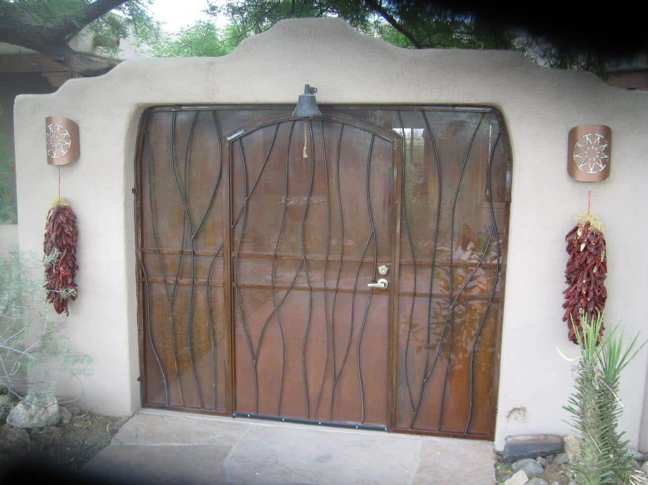 Patio enclosure with rust patina and irregular frame shape 6012 E. Unique wavy pattern. Made in Tucson