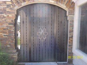 Patio enclosure with ornamental scroll work and alternate twist pattern 6001 E - Note the position of the security door behind the masonry wall. Made in Tucson