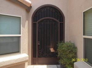 Porch enclosure with security door ornamented with knuckles and swirls 7011 E - Made in Tucson