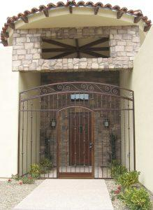 Porch security enclosure with knuckles, swirls and twisted bars 7009 E - rust patina - Made in Tucson
