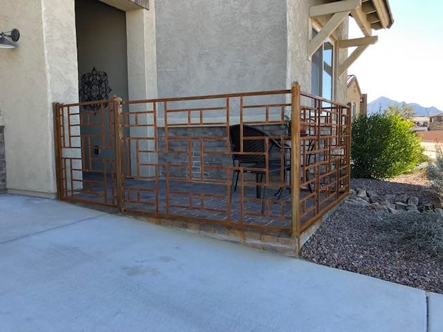 Rust iron fence and gate with a geometric motif 1694 - Installed in Tucson