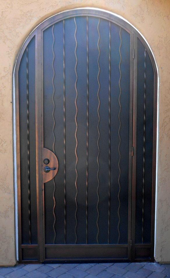 Security door and enclosure with alternate wavy and twisted patterns, and arched top 7016 E - Made in Tucson