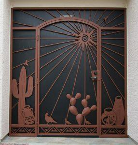 Security door and enclosure with multiple ornaments: Saguaro, Native American pottery, quails, cactus, sun and sunrays 6019 E - Made in Tucson