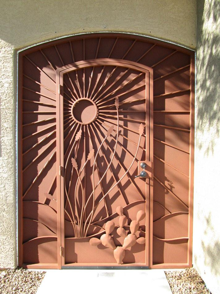 Security door and enclosure with southwestern ornaments: sun and sunrays, cactus, ocotillo 6020 E