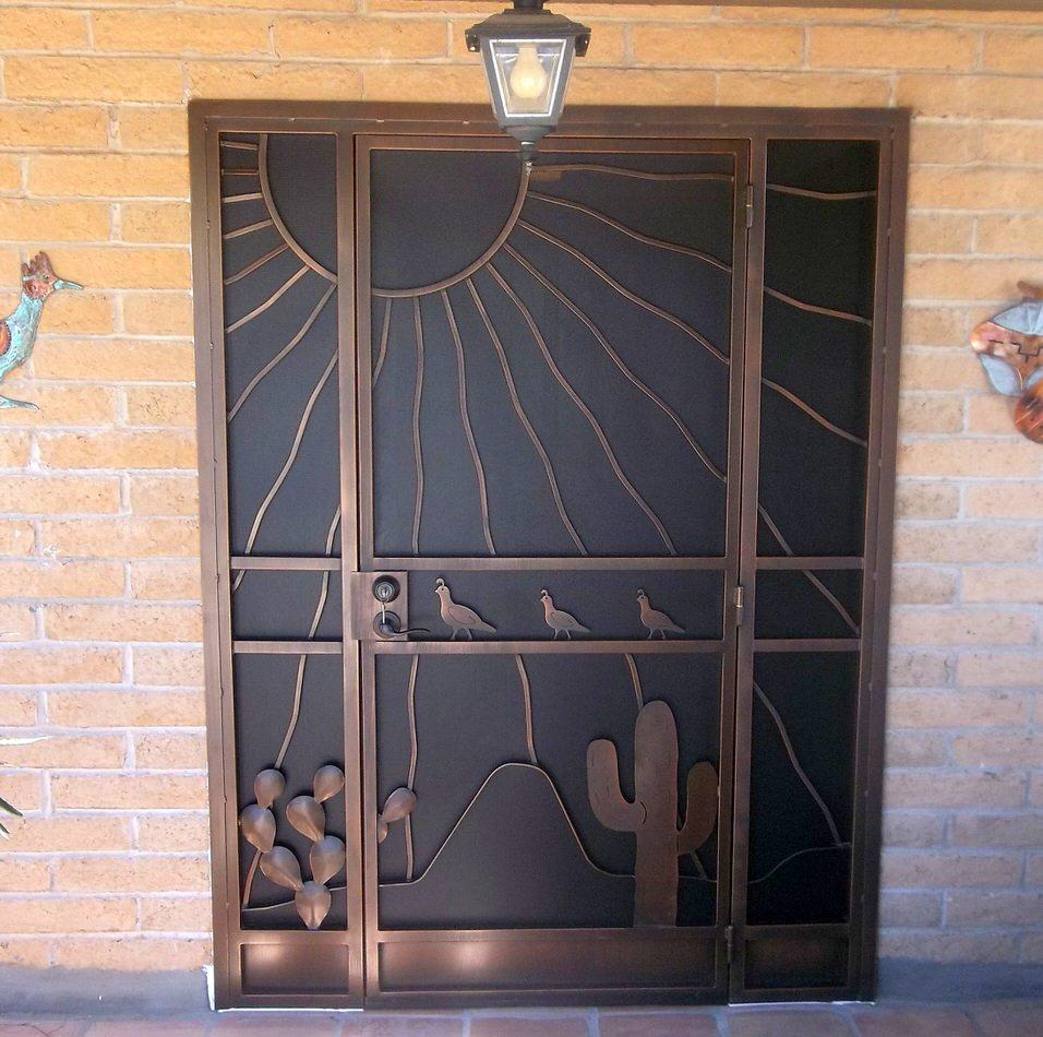 Security door and enclosure with southwestern theme: saguaro, cactus, quails, mountain and sunrays 6021 E - Made in Tucson