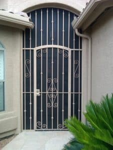 Security door enclosure with 3 panels - Painted and decorated with swirls 5000 E - Installed in Tucson