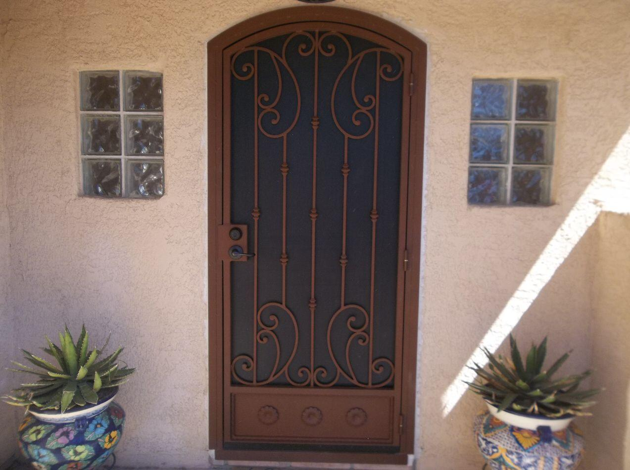 Security door with knuckles and scrolls 7012 E - Made in Tucson