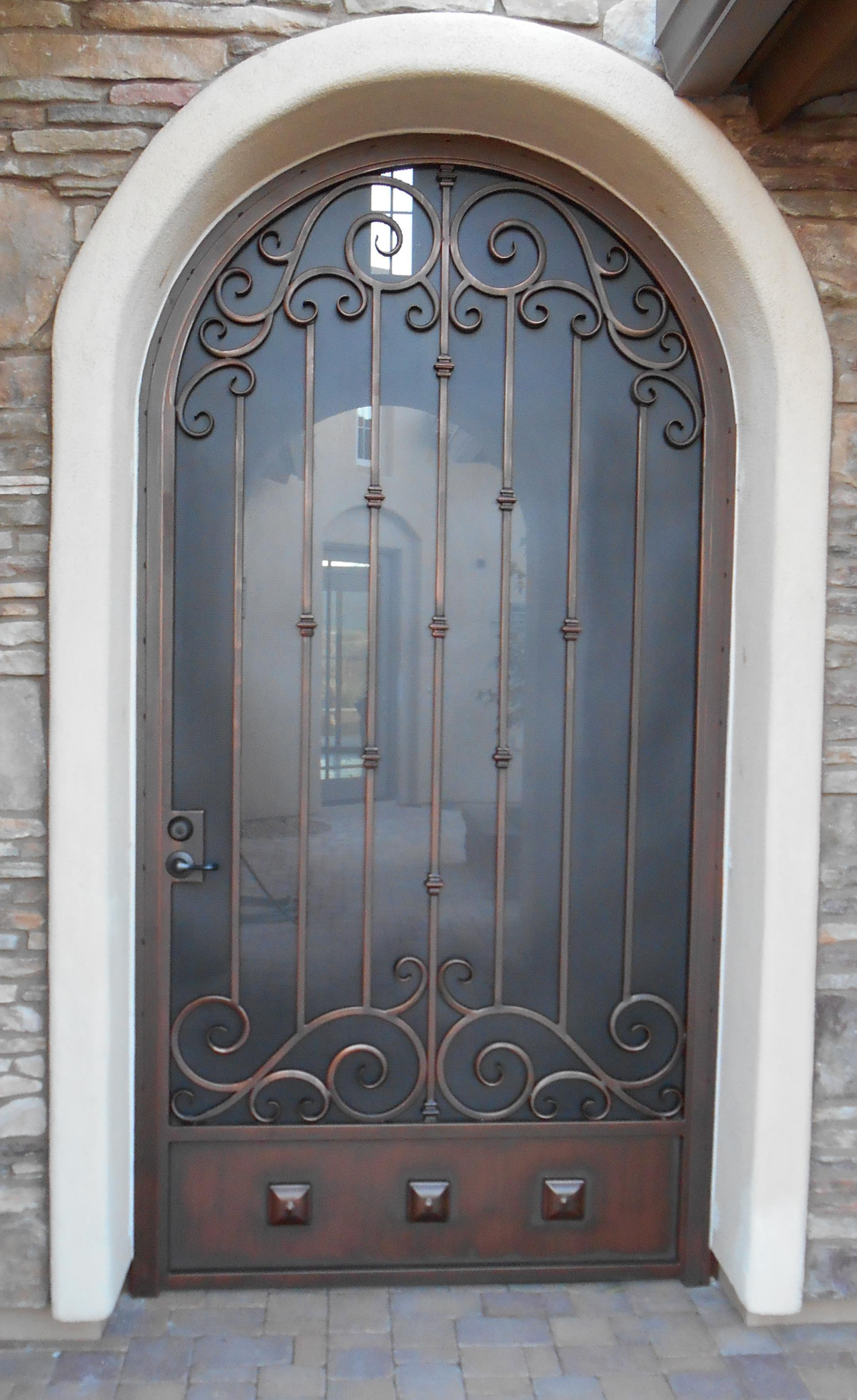 Security door with arched top ornamented with swirls 7004 E - Installed in Tucson
