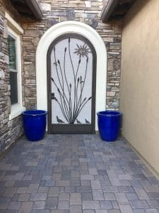 Security door with arched top and ocotillo, quails and sun ornament 0829 Installed in Tucson