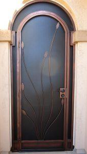 Security door with ocotillo and arched top 6022 E - Made in Tucson