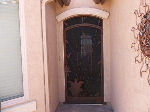 Security door with ocotillo and hummingbird 6005 E - Arched top - Installed in Tucson