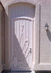 Security door with ocotillo and hummingbird cutouts - Painted white 6016 E - Installed in Tucson