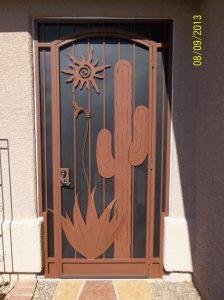 Security door with southwestern theme: hummingbird, saguaro, agave and sun - 6007 E - Installed in Tucson