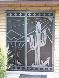 Security door with southwestern theme: quails, coyote, saguaro, mountains and sun 6011 E - Made in Tucson