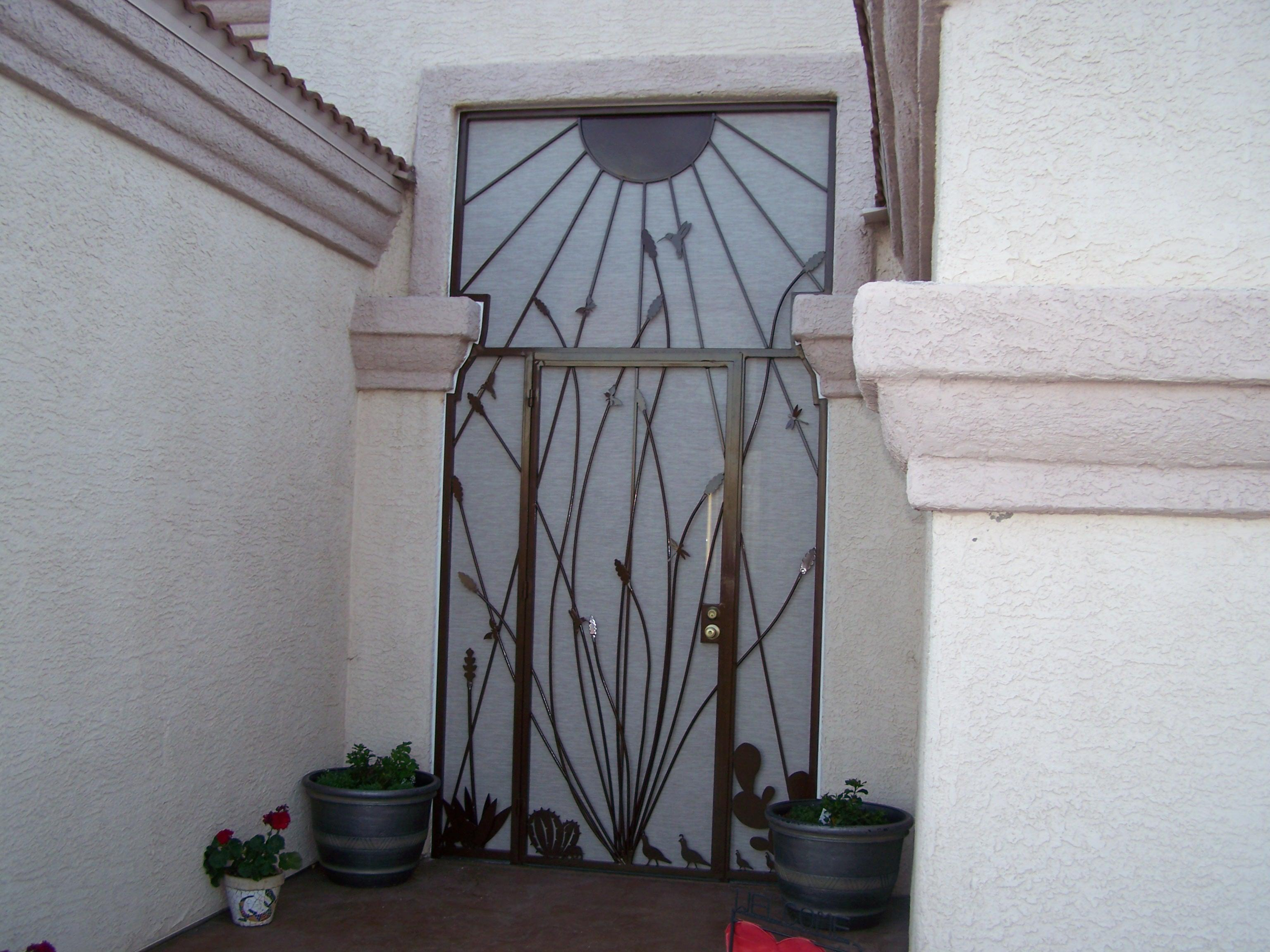 Security door with sunrays and ocotillo motifs - Features also quails, cancus hummingbird and agave 7003 E - Made in Tucson