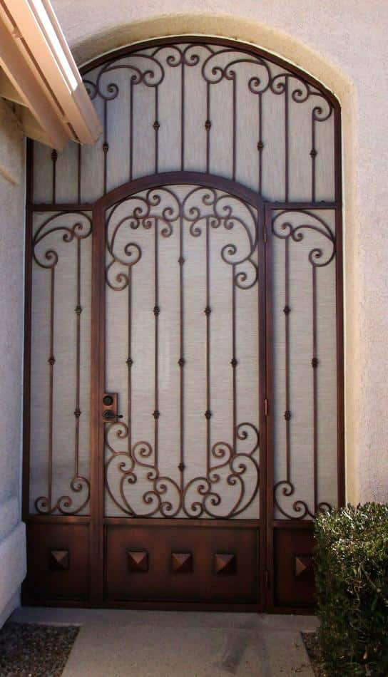 Security enclosure with an arched top and decorative scrolls and knuckles 7018 E - Made in Tucson