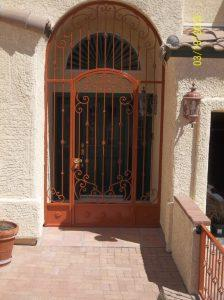 Security enclosure with scrolls and knuckles and decorative floral motifs on kick panels 7008 E - Installed in Tucson