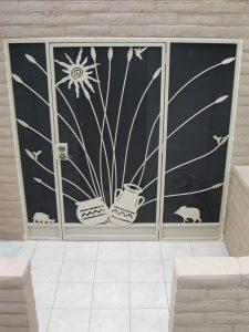 Security enclosure with southwestern design: javellina, Native American pottery, hymmingbird, ocotillo and turtle 6009 E