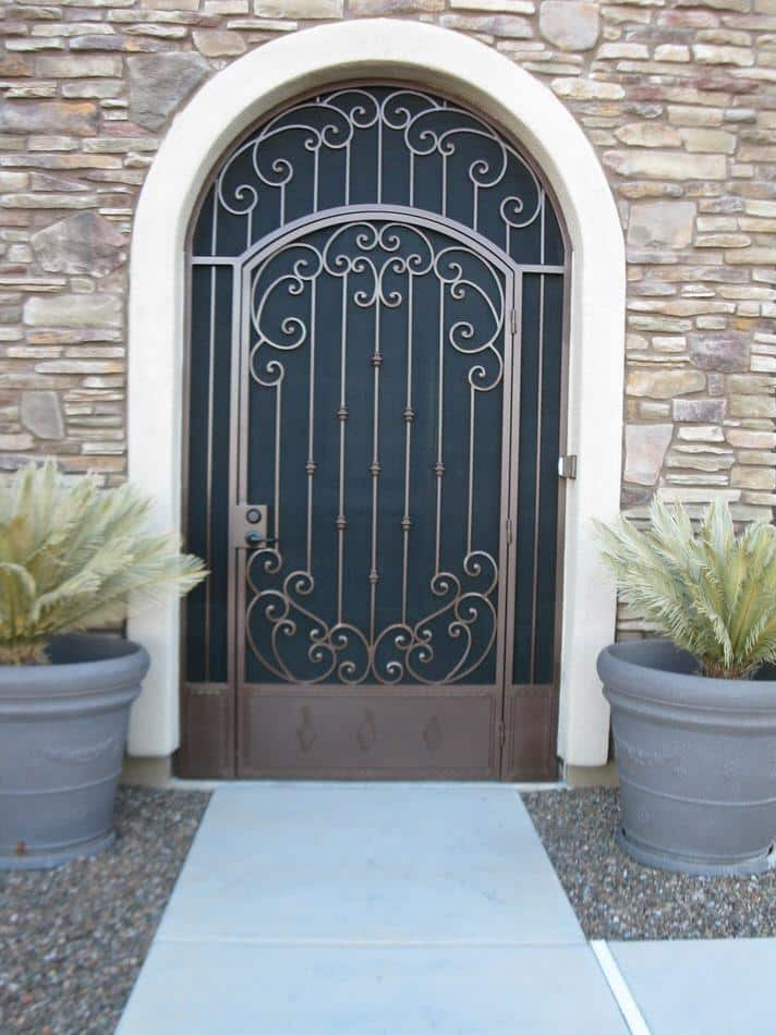 Security enclosure with arched top, swirls and knuckles 7002 E