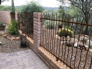 Wall-mounted iron rebar fence 0489 - Wavy rebar installed in Tucson