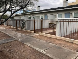 Wrought iron fence with rust patina 2145 - View fence and gates - New housing development