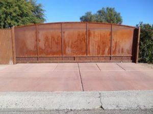 Rusted Driveway Gate | Corrugated Steel Fence with Rolling Gate | Rusted Metal Fence and Gate