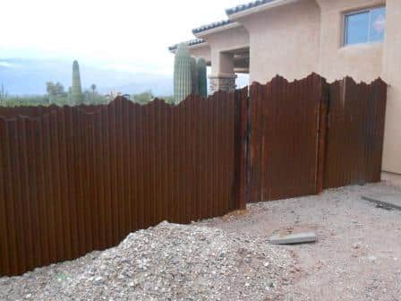 Corrugated Steel Fence with Mountain Top Design | Rusted Metal Fence
