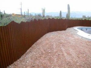 Corrugated Steel Fencing with Mountain Top Design | Rusted Metal Fence
