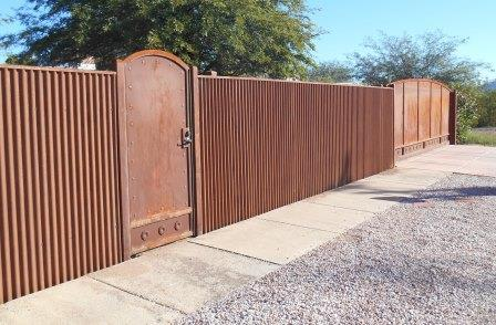 Sheet Steel Gate | Affordable Fence & Gates | Signature Ironworks | Corrugated Steel Gate | Rusty Corrugated Steel Gate | Natural Rust Corrugated Steel Gate | Arch | Rivets | Clevos | Handle | Court Yard Gate | Flower Detail | Natural Rust Color