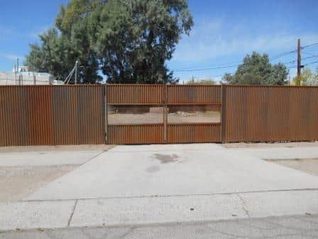 Affordable Fence & Gates   Signature Ironworks   Corrugated Steel Gate   Rusty Corrugated Steel Gate   Natural Rust Corrugated Steel Gate   Arch   Window Detail   Natural Rust Color