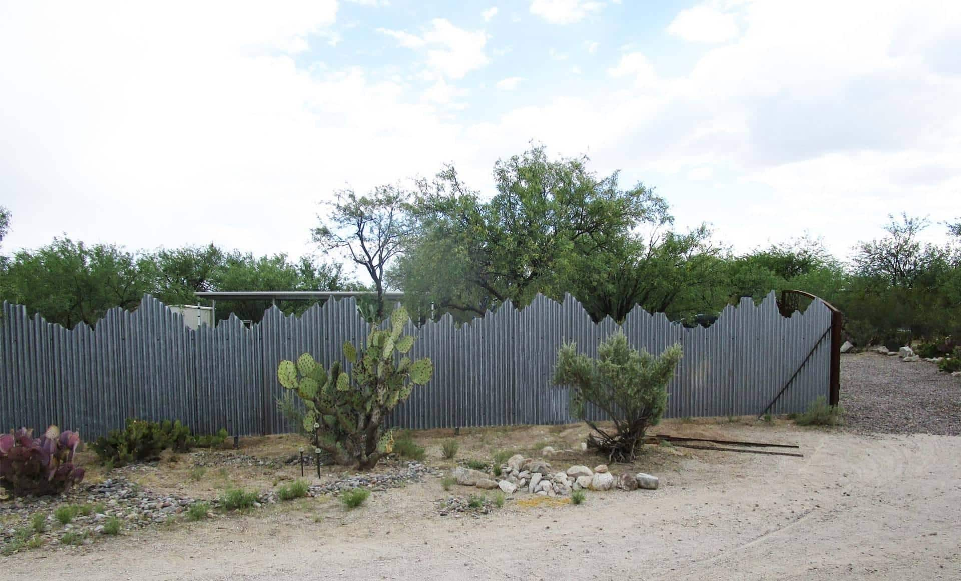 Corrugated Steel Fence with Mountain Cut