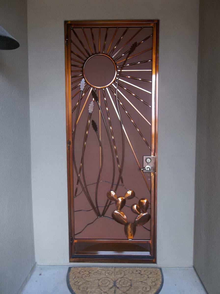 Security door with southwestern wrought iron decorations