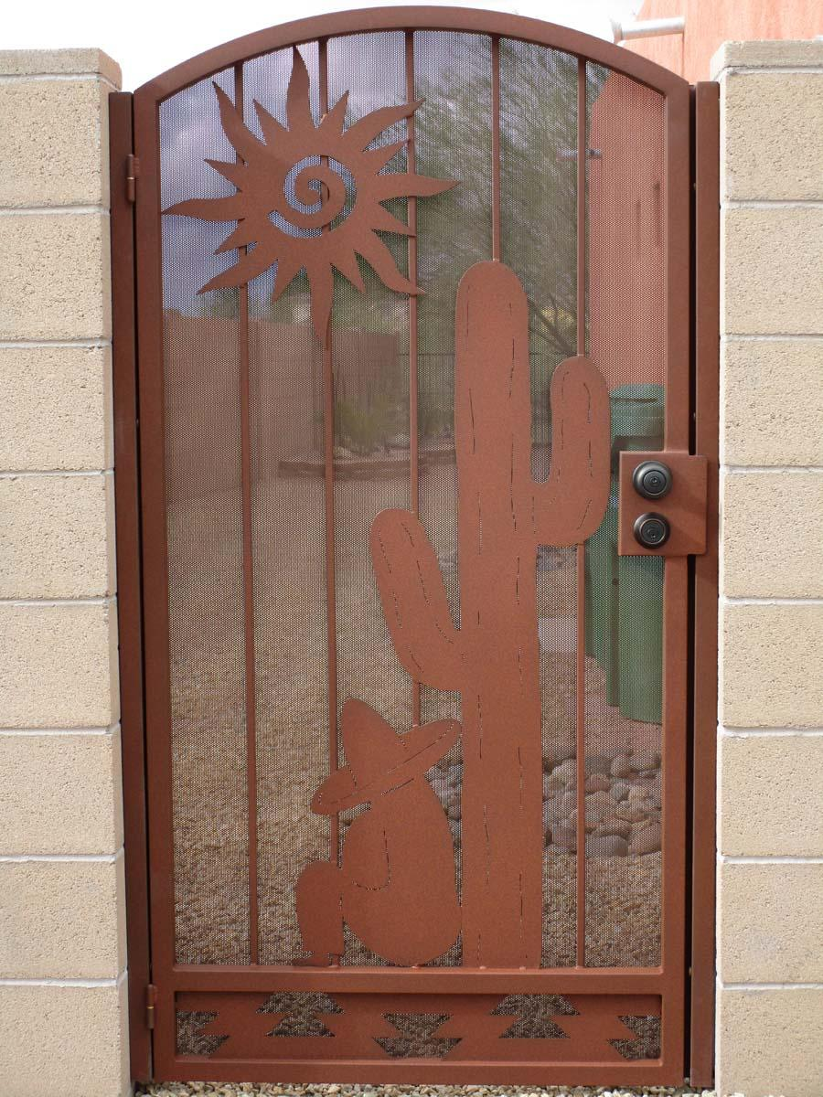 Rust colored iron gate with Southwestern design saguaro and sun