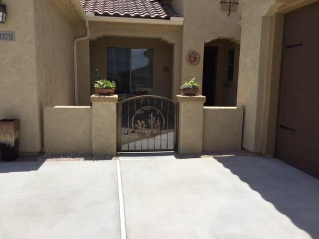 Arched-top wrought iron gate with scrolls and southwestern motifs - Made in Tucson