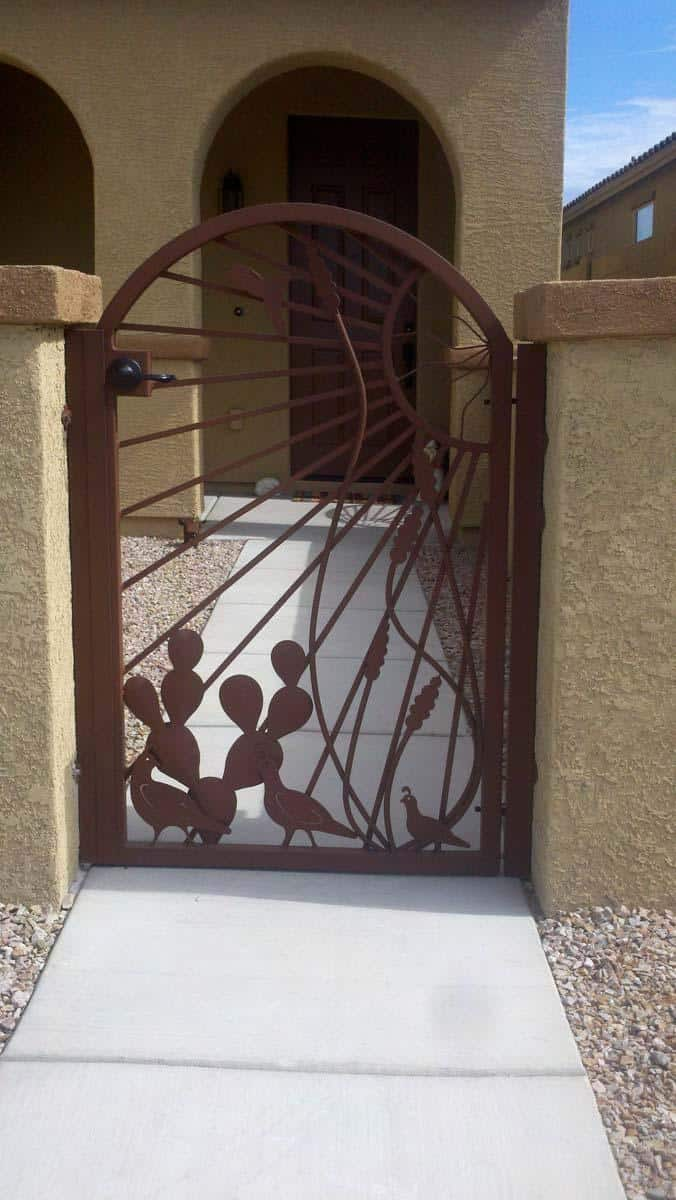 Arched-top wrought iron gate with southwestern motifs: quails, cactus, ocotillo and sun rays 092336235