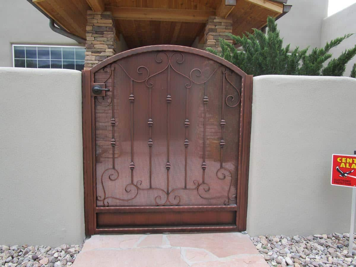 Arched wrought iron gate with hammered frame, scrolls and knuckles 863 IG
